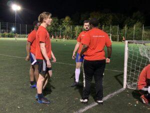CY volunteer mentors on the football field
